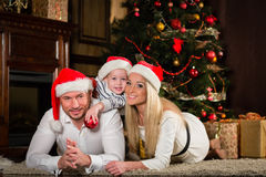 Happy family with Christmas gifts. Royalty Free Stock Image