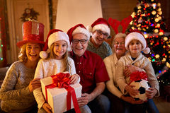 Happy family with Christmas gifts stock images