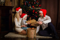 Happy family with Christmas gifts. Stock Images