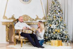 Happy family with Christmas gifts. Stock Photo