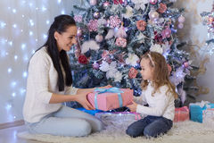 Happy family with Christmas gifts. Royalty Free Stock Images