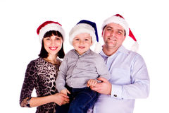 Happy family in Christmas hats Stock Images