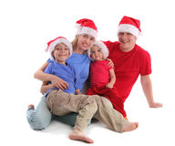 Happy family in Christmas hats. On white Royalty Free Stock Photo