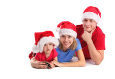 Happy family in Christmas hats Royalty Free Stock Images