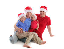 Happy family in Christmas hats Royalty Free Stock Photos