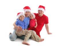 Happy family in Christmas hats. 2 Royalty Free Stock Photos
