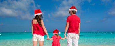 Happy family in Christmas Hats having fun on white Stock Photos