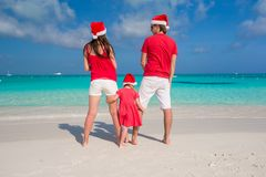 Happy family in Christmas Hats having fun on white Stock Image