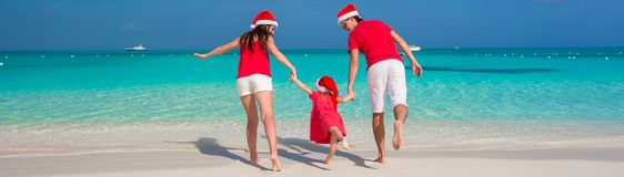 Happy family in Christmas Hats having fun on white Stock Images