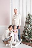 Happy young family in Christmas morning in home. look at the camera. Happy new year Royalty Free Stock Images