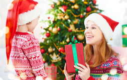 Happy family at Christmas. mother and child give gifts Stock Photos