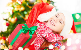 Happy family at Christmas. mother and child hugging and give gif Stock Photos