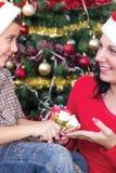 Happy family at Christmas night Stock Photos