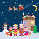 Happy family in the christmas night Royalty Free Stock Photo