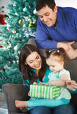 Happy family with Christmas present Stock Photos