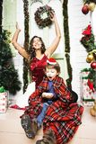 Happy family on Christmas in red hats Royalty Free Stock Photography