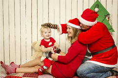 Happy family on Christmas Stock Images