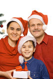 Happy family at Christmas time Royalty Free Stock Photos