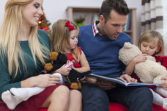 Happy family in Christmas time Royalty Free Stock Image
