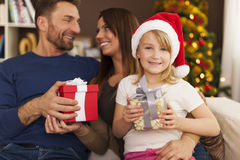 Happy family in Christmas time Stock Photos