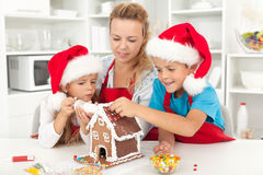Happy family at christmas time in the kitchen royalty free stock photos