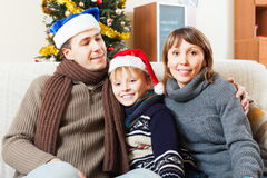 Happy family at Christmas time Stock Photo