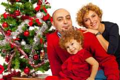 Happy family with Christmas tree Stock Image