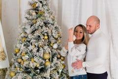 Happy family and Christmas tree. Royalty Free Stock Photo
