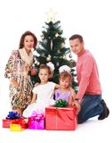 Happy family at the Christmas tree Stock Photography