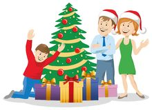 Happy family at the Christmas tree with gifts. Family at the Christmas tree with gifts Royalty Free Stock Photography