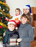 Happy family with Christmas tree Stock Photo