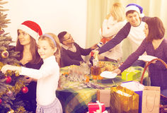 Happy family with Christmas tree at home Stock Photo