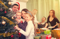 Happy family with Christmas tree at home Royalty Free Stock Images