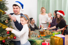 Happy family with Christmas tree at home Royalty Free Stock Photo