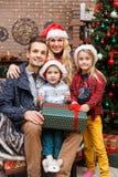 Happy family in Christmas tree Royalty Free Stock Photos