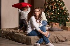 Happy family and Christmas tree. Stock Image