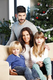 Happy family at christmas tree Royalty Free Stock Photo