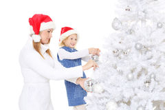 Happy family and Christmas tree. Royalty Free Stock Images
