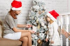 Happy family and Christmas tree. Royalty Free Stock Photos