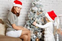 Happy family and Christmas tree. Stock Photo