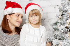 Happy family and Christmas tree. Stock Image