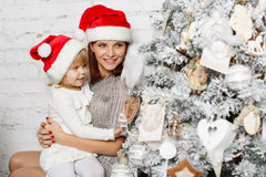 Happy family and Christmas tree. Royalty Free Stock Image