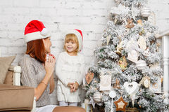 Happy family and Christmas tree. Stock Photo