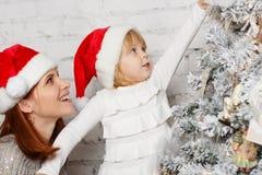 Happy family and Christmas tree. Stock Photos