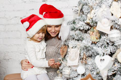 Happy family and Christmas tree. Stock Images