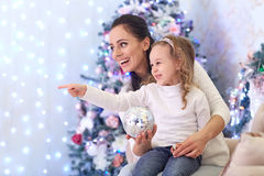 Happy family and Christmas tree. Royalty Free Stock Photo