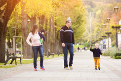 Happy family in a city park Royalty Free Stock Photos