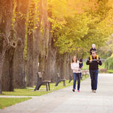 Happy family in a city park Royalty Free Stock Images
