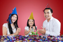 Happy family clapping in a birthday party Stock Photo