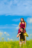 Happy Family  with Clouds and Grass Stock Photography